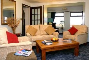 Main crofthouse lounge space with panoramic views