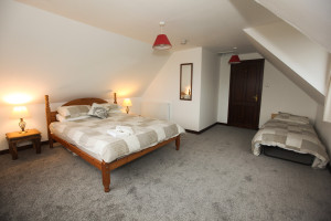 A very spacious bedroom with dual-aspect sea views